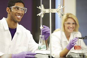 College students in lab conducting titrations