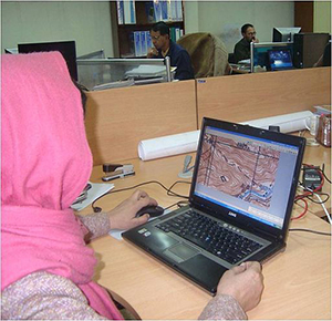 Female engineer in Afghanistan working on a laptop