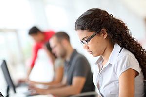 High school girl focused on computer work